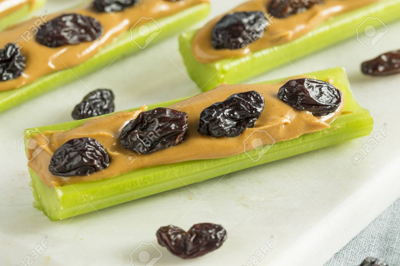 84785956-homemade-ants-on-a-log-snack-with-celery-peanut-butter-and-raisins.jpg